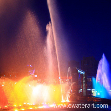 large water fountain light show in lake